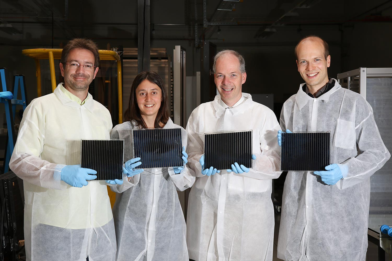 R&D Team at Solaronix holding Perovskite Solar Modules out of their prototype factory.